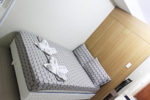 Shell Residences by Homebound Serviced Apartment Deluxe Room